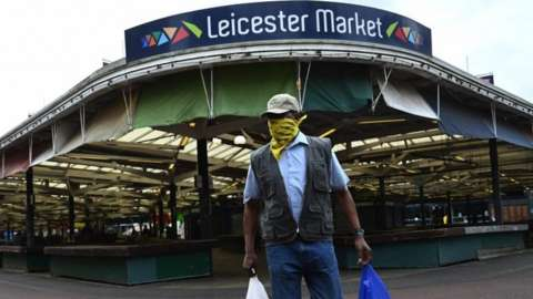 Man at Leicester Market with a mask on