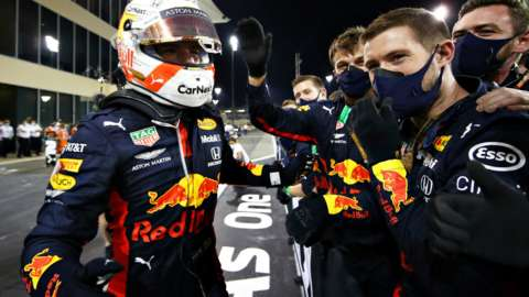 Max Verstappen celebrates with Red Bull pit crew after win in Abu Dhabi