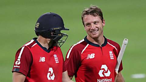 England's Dawid Malan and Jos Buttler celebrate after winning