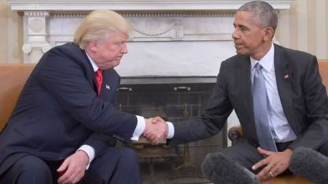 Donald Trump and Barack Obama shake hands in the White House
