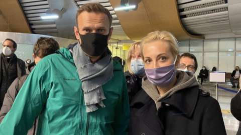 A handout picture posted by Kira Yarmysh, press-secretary of Alexei Navalny, shows Russian opposition leader and anti-corruption activist Alexei Navalny (L) and his wife Yulia (R) before passing the border control at the Sheremetyevo airport in Moscow, Russia, 17 January 2021.