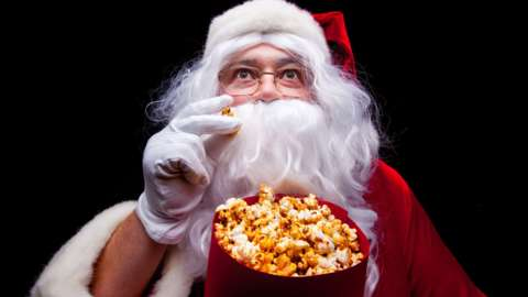 Father Christmas watching a film