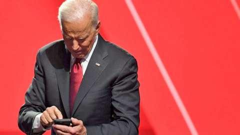 Joe Biden checking his phone