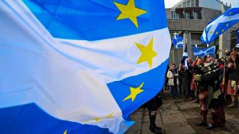 piper and Scotland/EU flag