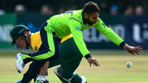 South African batsman David Miller and Simi Singh collide at Stormont