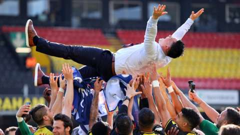 Watford players celebrate promotion with boss Xisco Munoz