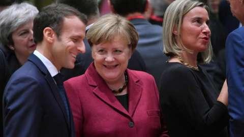 French President Macron and German Chancellor Merkel speak at an EU summit