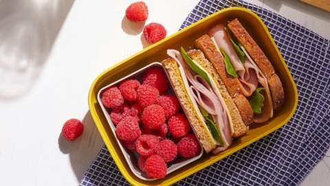 Raspberries and a sandwich