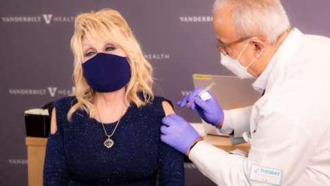 Singer Dolly Parton receives a vaccination against the coronavirus at Vanderbilt University Medical Center in Nashville, Tennessee