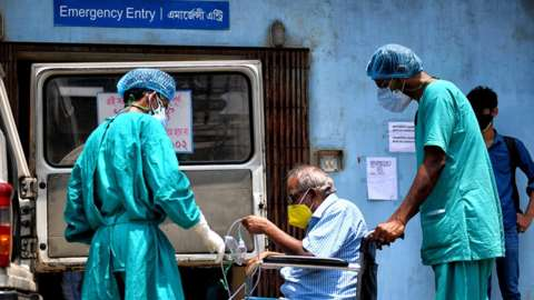 A Covid-19 patient seen on a wheel chair going for a medical check up at a government hospital.India has recorded the highest single-day spike in coronavirus infection, 28 April 2021