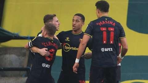 Watford players celebrate Dan Gosling's goal at Norwich