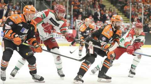 Cardiff Devils and Sheffield Steelers in action
