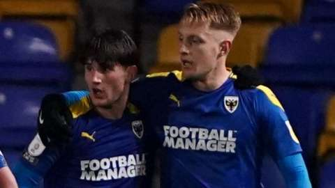 Ryan Longman and Joe Pigott scored AFC Wimbledon's goals