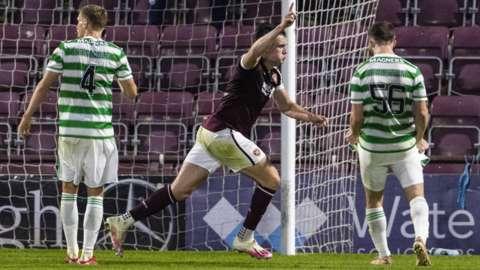 John Souttar celebrates after heading home Hearts' late winner