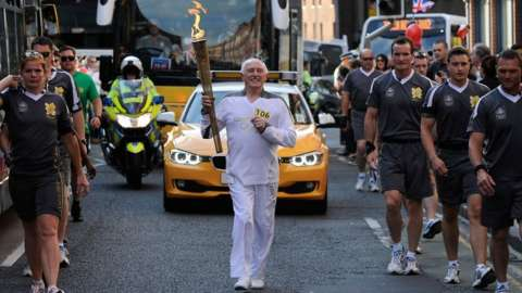 Stan Wild with Olympic torch in 2012