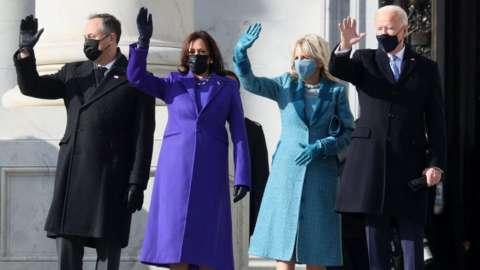 Second husband Doug Emhoff, Vice-President Kamala Harris, First Lady Jill Biden, and President Joe Biden wave to the crowd