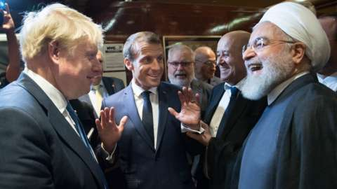 British Prime Minister Boris Johnson (left), French President Emmanuel Macron (centre) and Iran's President Hassan Rouhani (right) discuss at the UN General Assembly in New York on 24 September 2019.