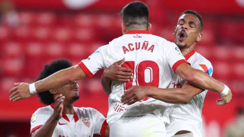 Sevilla's players celebrate scoring against Atletico Madrid