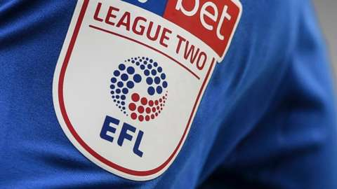 League Two badge on shirt