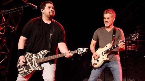 Wofgang Van Halen and father Eddie playing guitar onstage