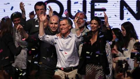 Mauricio Macri and his supporters celebrate as confetti falls