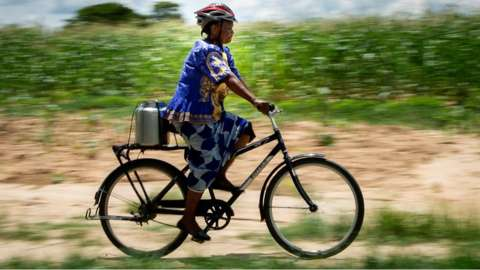 Woman on bike in Zambia