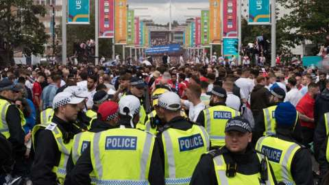 Police officers patrol outside Wembley Stadium before the Euro 2020 final between Italy and England