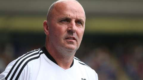 Paul Cook watches on