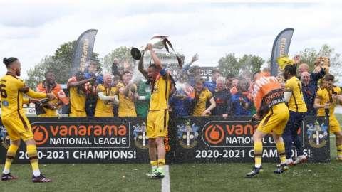 Sutton United players celebrate