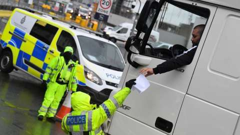 Police check lorry documentation at Dover