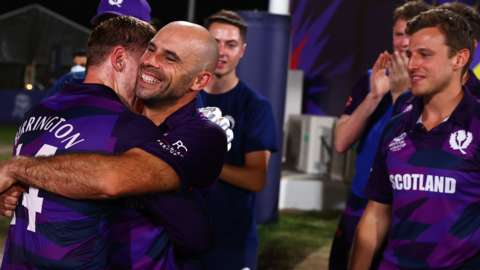 Richard Berrington and Kyle Coetzer of Scotland embrace following the ICC Men's T20 World Cup match between Oman and Scotland