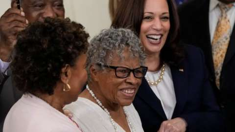 94-year-old activist and retired educator Opal Lee holds hands with Vice President Kamala Harris in the White House as law making 19 June a national holiday is signed