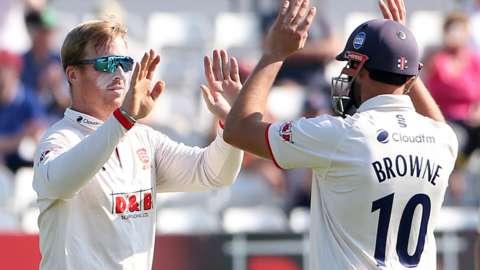 Essex bowler Simon Harmer (left) celebrates a wicket