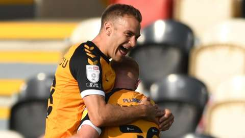 Ryan Taylor (29) of Newport County celebrates scoring his side's second goal with Mickey Demetriou