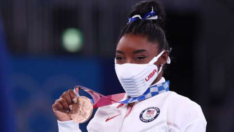 Simone Biles with her bronze medal
