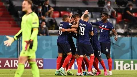 France players celebrate behind Germany goalkeeper Manuel Neuer
