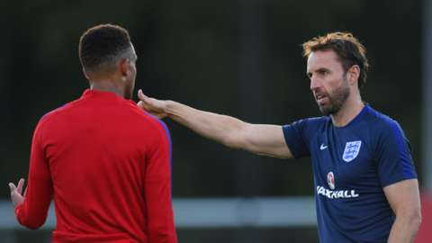Gareth Southgate speaks to Brendan Galloway during the U21 training session at St Georges Park on September 2, 2016 in Burton-upon-Trent, England.