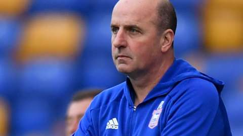 Ipswich boss Paul Cook watches on