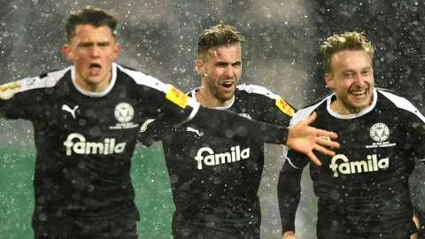 Holstein Kiel celebrate beating Bayern Munich