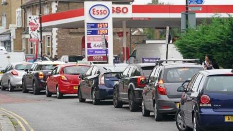 Motorists queue for petrol at an Esso petrol station in Brockley, South London. Picture date: Saturday September 25, 2021