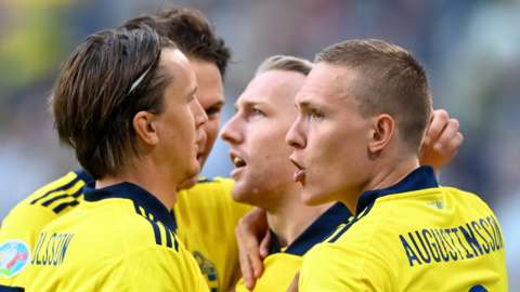 Sweden's players celebrate scoring against Poland at Euro 2020
