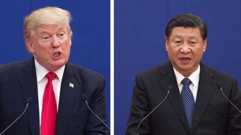China's President Xi Jinping speaks next to US President Donald Trump during a business leaders event at the Great Hall of the People in Beijing on November 9, 2017.