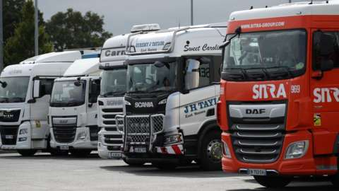 Lorries sitting at a service station