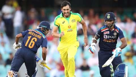 Australia's Mitchell Starc with India's Mayank Agarwal and Shikhar Dhawan