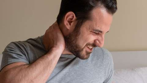 Stock image of a man in pain
