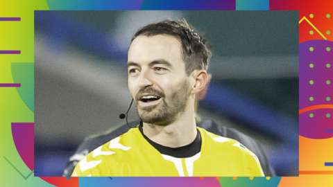 A photo of Super League referee James Child during a match on the BBC Sport LGBT+ History Month colourful and patterned background