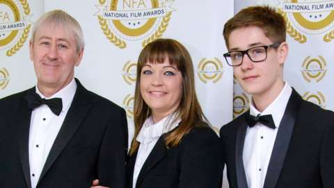 Archie Lyndhurst with his mother and father at The National Film Awards.