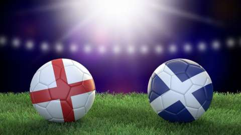 Footballs with the England and Scotland flags on
