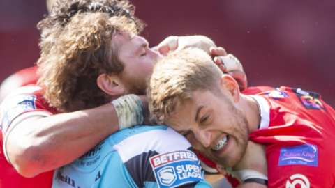 Lee Mossop tackles Scott Taylor with his mouthguard showing
