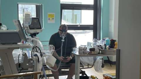 Matthew Keenan photographed in Hospital on CPAP machine